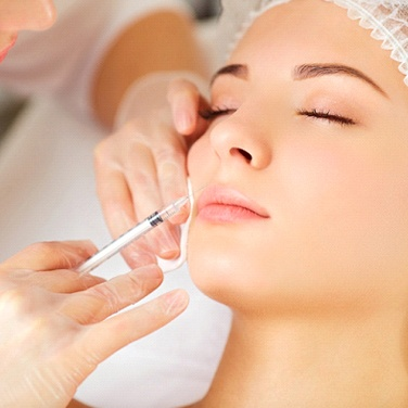 A woman having Botox injected