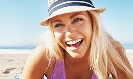 woman at beach smiling