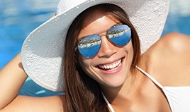 woman with sun hat smiling