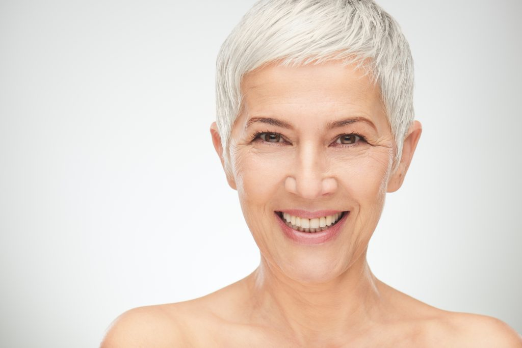 older woman smiling perfect teeth