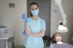 Dental hygienist and patient at dentist.